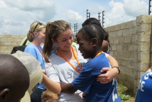 Ellen Kershaw hugs Hope upon arrival at The orphanage.