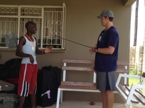 Kershaw shows orphanage resident Peter how to stretch before pitching.