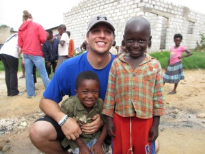 Shawn Tolleson with two youngsters in the Ngombe community.