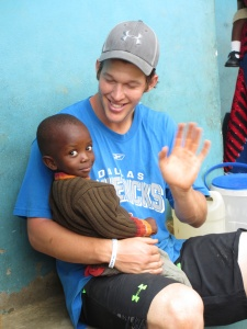 Clayton Kershaw spending a few moments with a young boy.